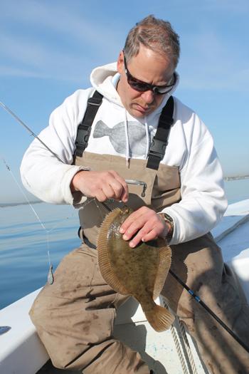 Capt. Jason Colby shows off a flounder taken this April.